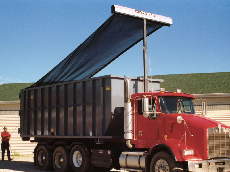 The Hy-Tower™ semi-automatic roll-off tarp system covers containers from 15 to 40 cubic yards, with a gantry that raises either 12 or 15 feet above the truck frame and then tucks compactly behind the cab during transport.
